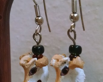 Cow bead drop-style earrings. Hand painted bone with glass beads; ball and coil fishhook wire findings