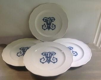 Set of 4 lovely plates with monogram HV