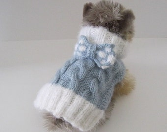 SMALL dog sweater is an adorable light blue with fuzzy white angora collar and cuff and matching checkered knit bow!  Soft, warm and cozy!
