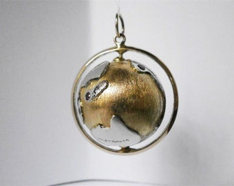 14kt Gold Diamond and Ruby Movable Globe Charm