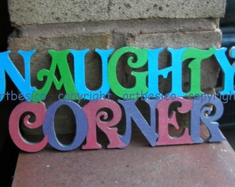 Wood letters sign - Naughty Courner - all capital letters