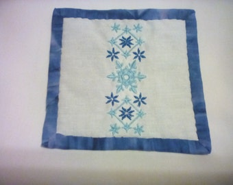 snowflake embroidered Mug Rug