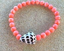 Peach Coral and Seashell Stretch Bracelet. Hawaiian Style Beach Bracelet with Cone Shell. Pink Faceted Semi Precious Gemstone Bead Bracelet.