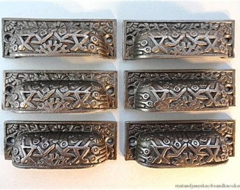 A set of 6 Inca design Victorian style cast iron cup handle IS1