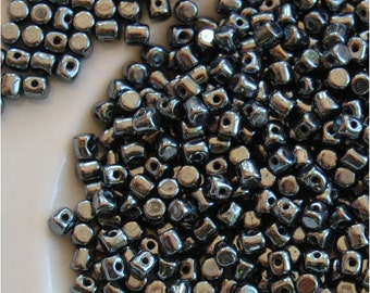 Minos® Par Puca® Beads, Jet Hematite, 23980/14400, sold in units of 10grams