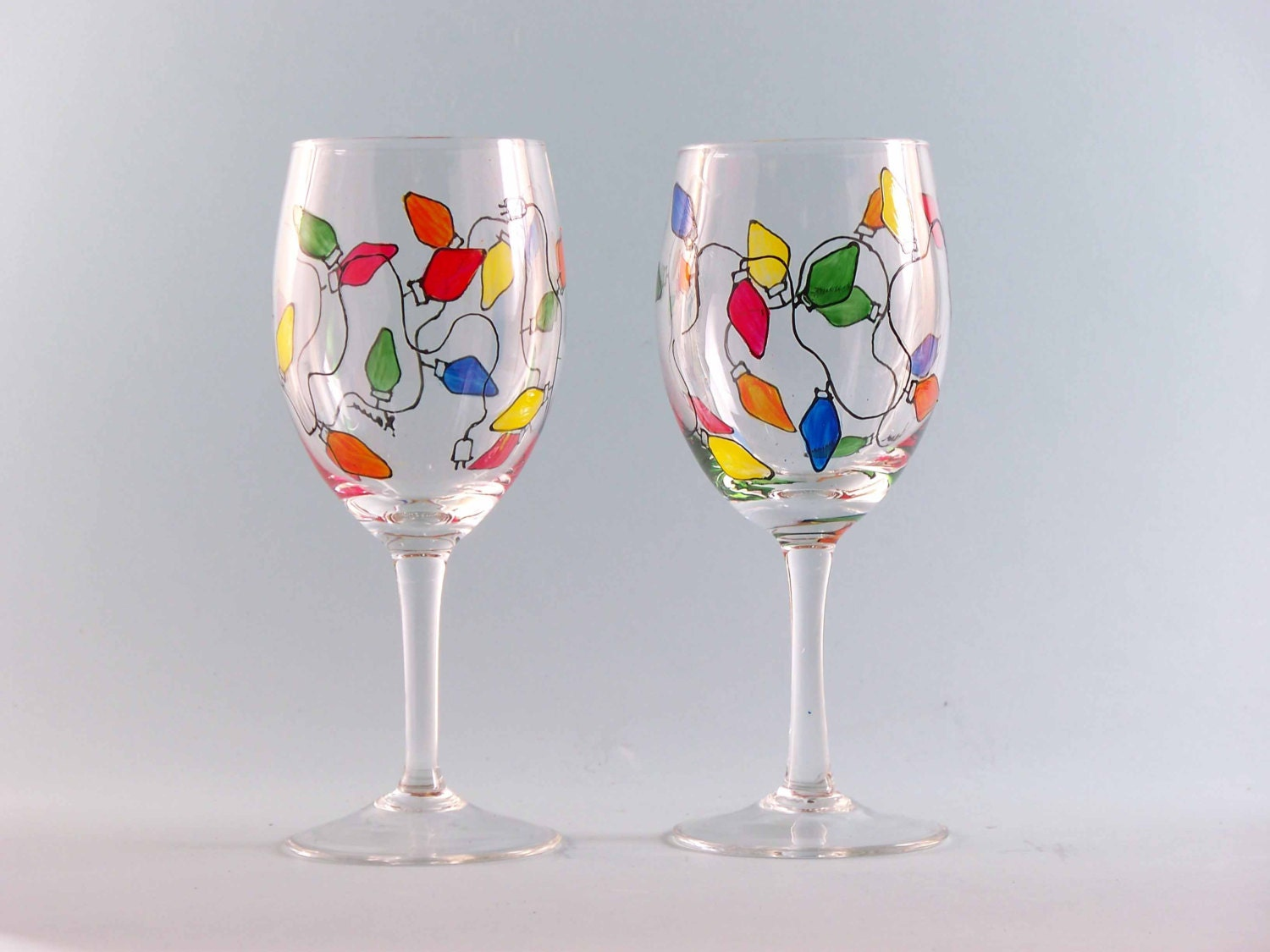 Christmas lights wine glasses hand painted by for Hand painted wine glass christmas designs