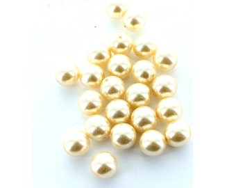 8mm creamrose pearls.  Price is for 50 pearls