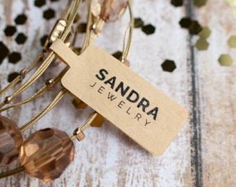 Bold san serif jewelry logo tag sticker brown kraft