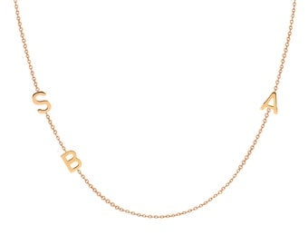 triple 14k gold asymmetrical initial necklace