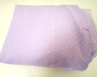 Light Purple or Lavender Fabric with white dots.  Semi sheer fabric.