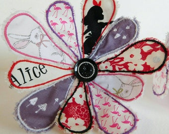 Handmade Alice in Wonderland, Lewis Carroll inspired cotton and wire flower with the White Rabbit, Alice, and flamingo contrasting petals.