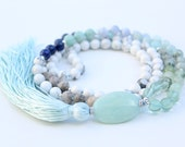 Blue Water Love Mala    Blue Gemstones, White Howlite, Fossil, Serenity, Communication, Peace, Calm, Courage