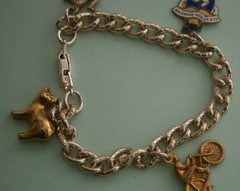 B618) A lovely vintage gold tone metal chain Isle of man Manx cat  motorcycle 3 legged man charm bracelet