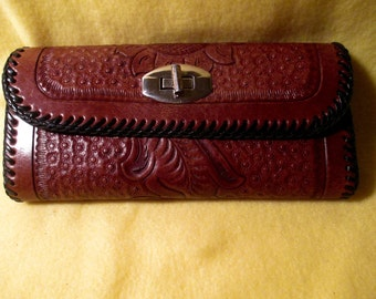 Hand tooled western clutch wallet.  Nice