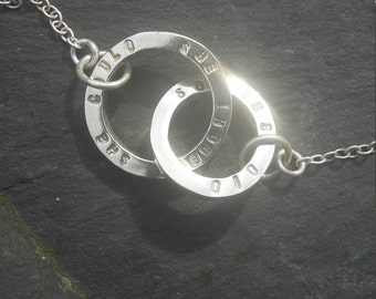 She thought she could so she did. Twin circle solid silver necklace with inspirational quote.