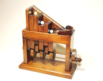 Marbles automata. Kinetic art - Wooden toys. Handmade