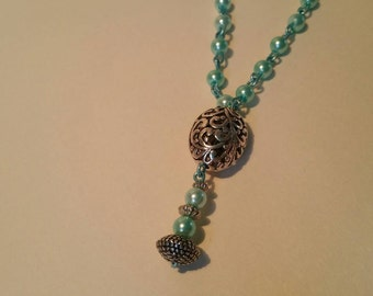 Beautiful long turquoise necklace.