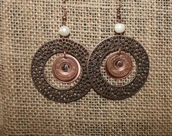 Copper hoop earrings with genuine 20 gauge Remington/Peters shotgun shell metal.