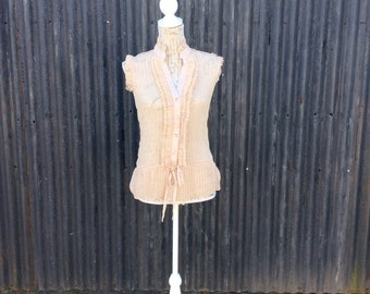 Beautiful vintage sheer sleeveless ribbon tie blouse