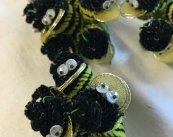 Vintage yellow and black Bumble Bee made of pipe cleaners with google eyes