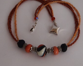 Necklace in Lampwork Crystal Beads in Ivory,Peach and Black, Adventurine,Goldstone, Crystals and Sterling Silver
