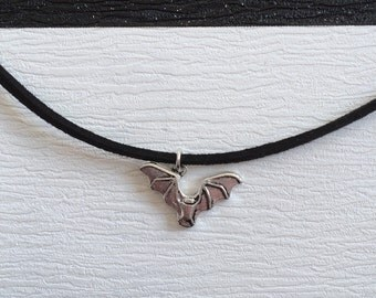 black suede choker with bat charm