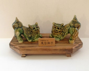 Foo Dogs Pair of Green and Tan Foo Dogs on Wood Stand