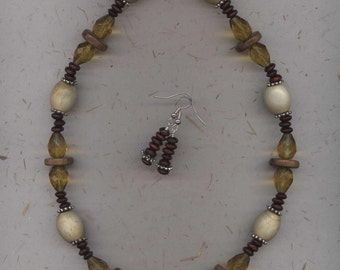 Necklace & earrings in the perfect summer mix of light and dark wood beads with golden mustard faceted glass teardrops