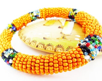 Festival Gorgeous vintage seed bead wrapped BoHo bangle bracelet. Juicy orange with spaced multicolor glass beads