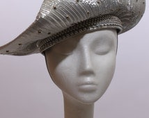 80s pleated silver lame hat asymmetric wide brim metallic glam studded shiny party wild vegas flashy statement studs embellished