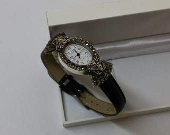 Exponent wrist watch with Markasiten UU107
