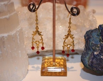 Gold Filigree chandelier style earrings with red crystal drops