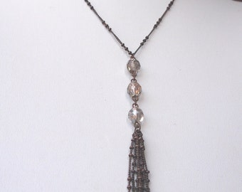 Vintage antique bronze tone metal necklace with clear faceted beads.