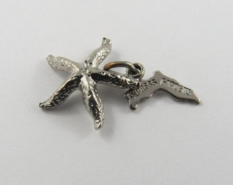 A Starfish with Cypress Gardens Tag Attached Silver Charm of Pendant.