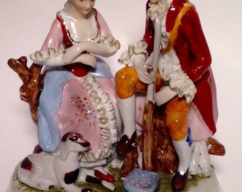 Colonial sculpture of a Lady & her Suitor/Soldier or Huntsman Dandy with Gold Detailing (F)