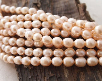 Strand Freshwater Pearls Peach Pink Rice Shape 8 x 7mm approximately 47 Pearls