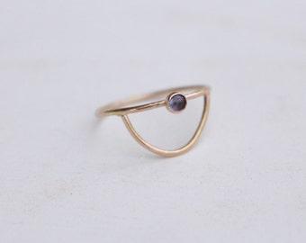 14 K half moon ring with Tanzanite