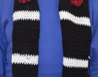 Black and white knit scarf with red flower embelishments