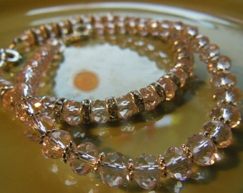 Pale pink bracelet set with crystal spacer