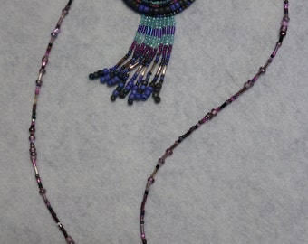 blue, purple and pink bead embroidered pendant
