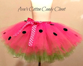 Watermelon tutu! It's almost summer and this is the perfect tutu for it. Bright pink and green tutu with black seeds and matching ribbon!