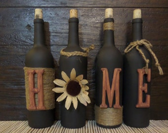 Decorated Wine Bottles spelling  HOME. Home decor. Decorated wine bottles.