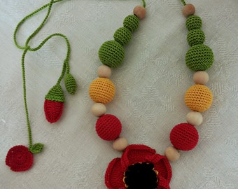 Poppy necklace with crochet children feeding/necklace, wood beads coated in Lisle.