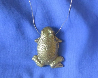 brass sand casted pendant: frog, chicken bone, monkey and botton