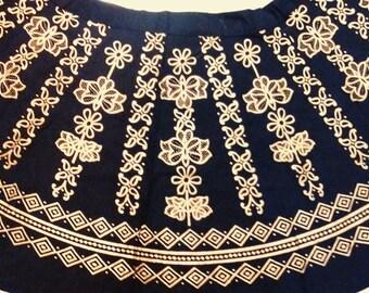 Black wrap skirt with golden design.