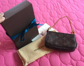 Authentic Louis Vuitton with box and dust bag