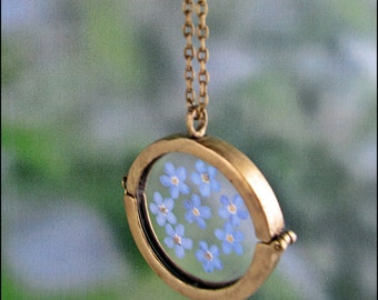 True forget-me-not flowers in a glass Locket