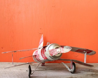 vintage folk art airplane . Schlitz beer can airplane . handmade primitive model biplane