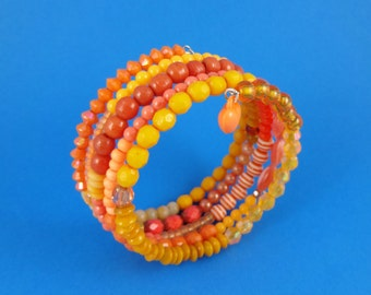 Orange Memory Wire Bangle - Stacked coils bangle, mixed orange beads, wrap around layered look, shades of orange, boho folk gypsy tribal fun