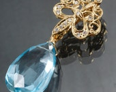 28.20ct Natural Blue Topaz Pendant Emhancer